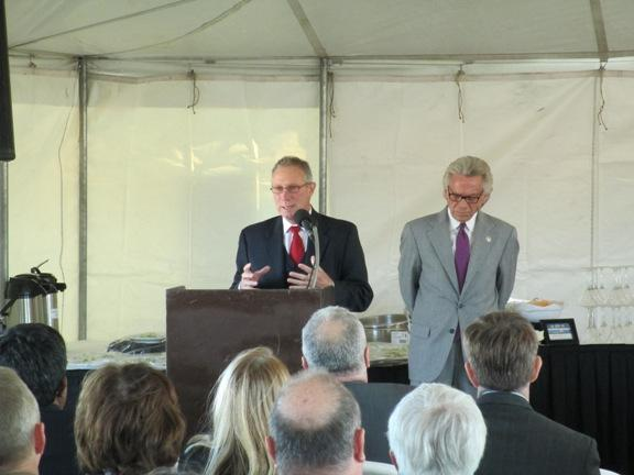 Investor Pete DeKalb speaks at the 2nd Street groundbreaking ceremony.