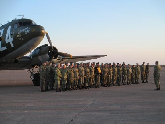 Members of the World War II Airborne Demonstration Team gather for a picture.