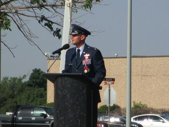 Col. Anthony Krawietz, the departing commander, gives remarks at the Altus Air Force Base change of command ceremony.