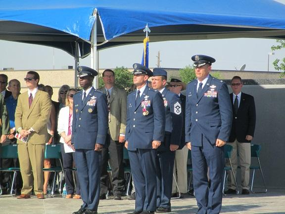 General Edward Rice Jr., outgoing commander Col. Anthony Krawietz, and incoming commander Col. William Spangenthal at the Altus AFB change of command ceremony.