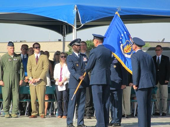 Col. William Spangenthal accepts the flag as the new commander of the 97th Air Mobility Wing.