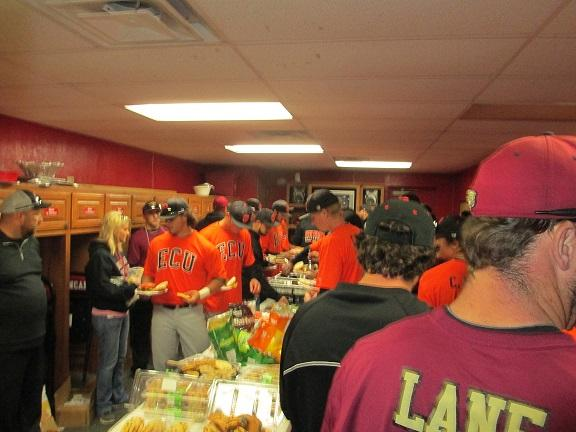 The teams sharing a postgame meal provided by Duncan baseball boosters.