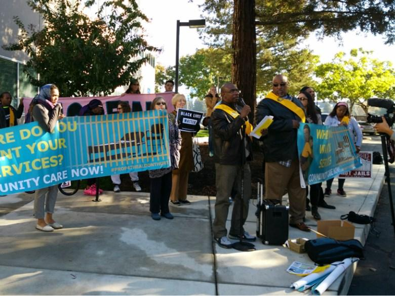 Protestors object to new funding for California jails, outside of the Board of State and Community Corrections meeting.
