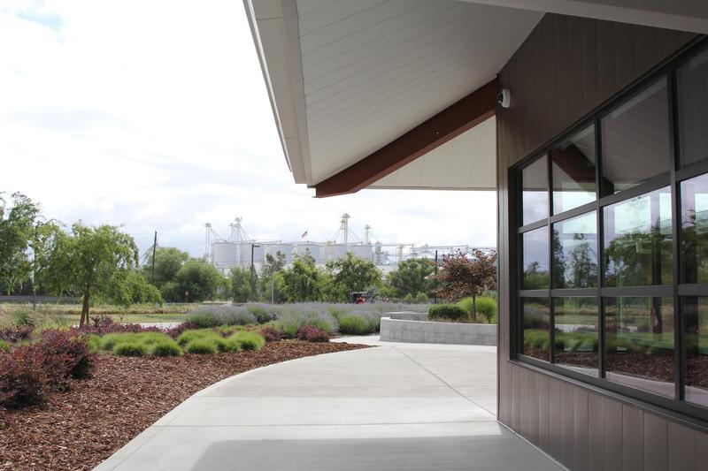 Looking across the Lundberg Family Farms LEED-certified flagship headquarters in Richvale to the agricultural silos of the region.