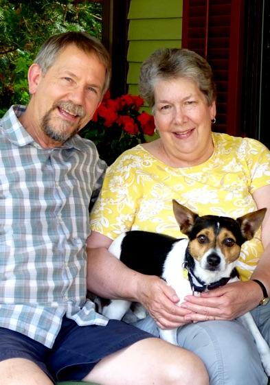 Scott and Jane Kunst, with Toby on the porch at their home in Ann Arbor, Michigan.