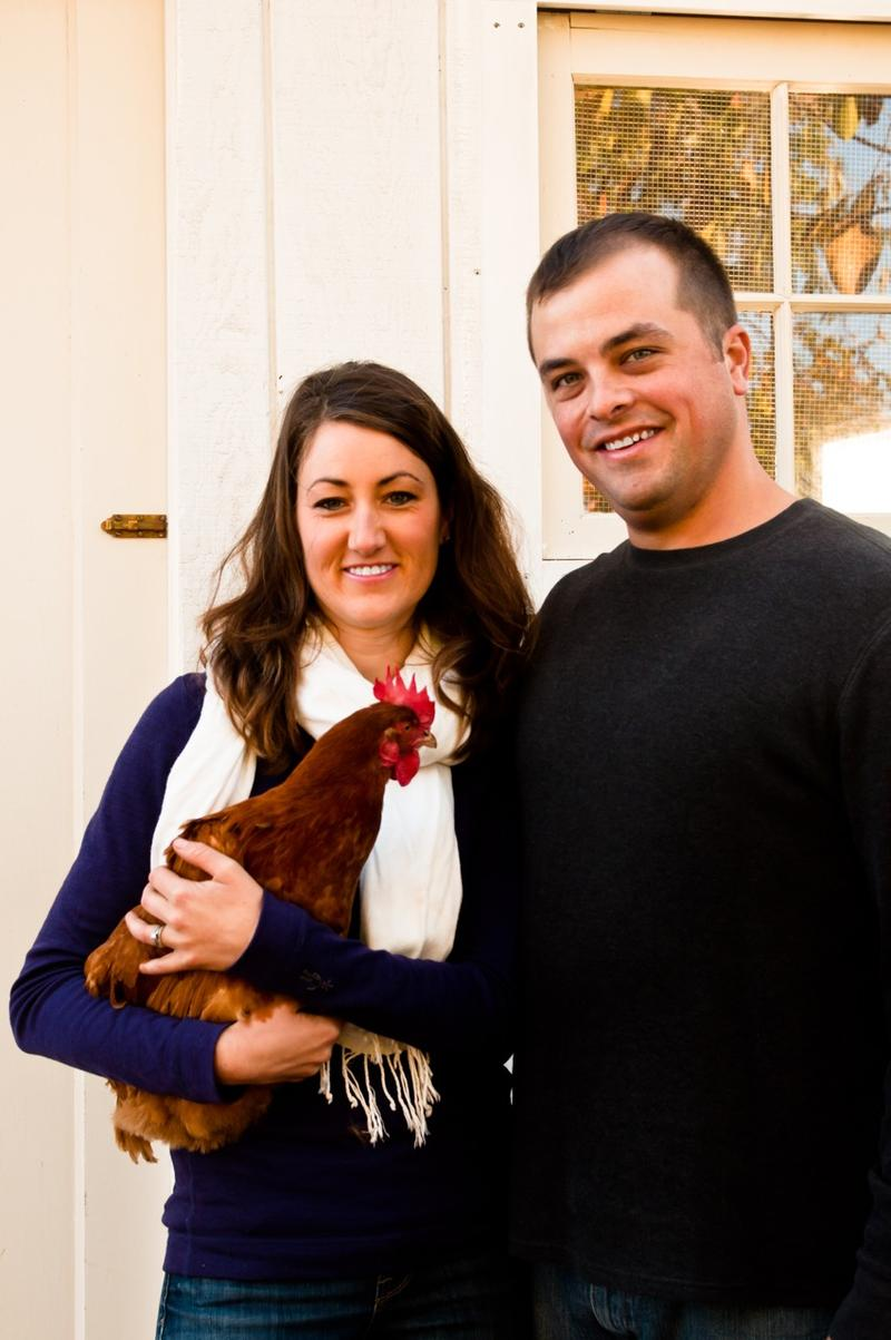 Melissa and Matt Keyser in the garden with one of their beloved hens
