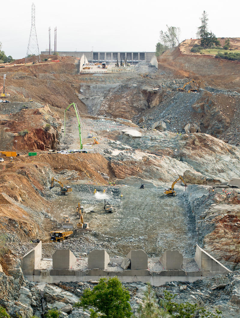 Kiewit Infrastructure continues to remove concrete  broken up by controlled blasts on the lower chute of the Lake Oroville flood control spillway in Butte County, California. Photo taken June 12, 2017.