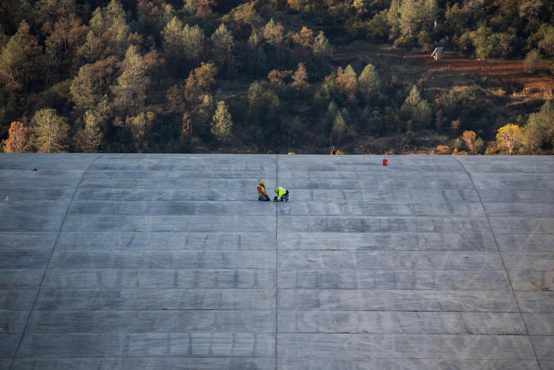 Workers continue finishing work on the upper chute of the Lake Oroville flood control spillway in Butte County, California. Photo taken November 22, 2017.