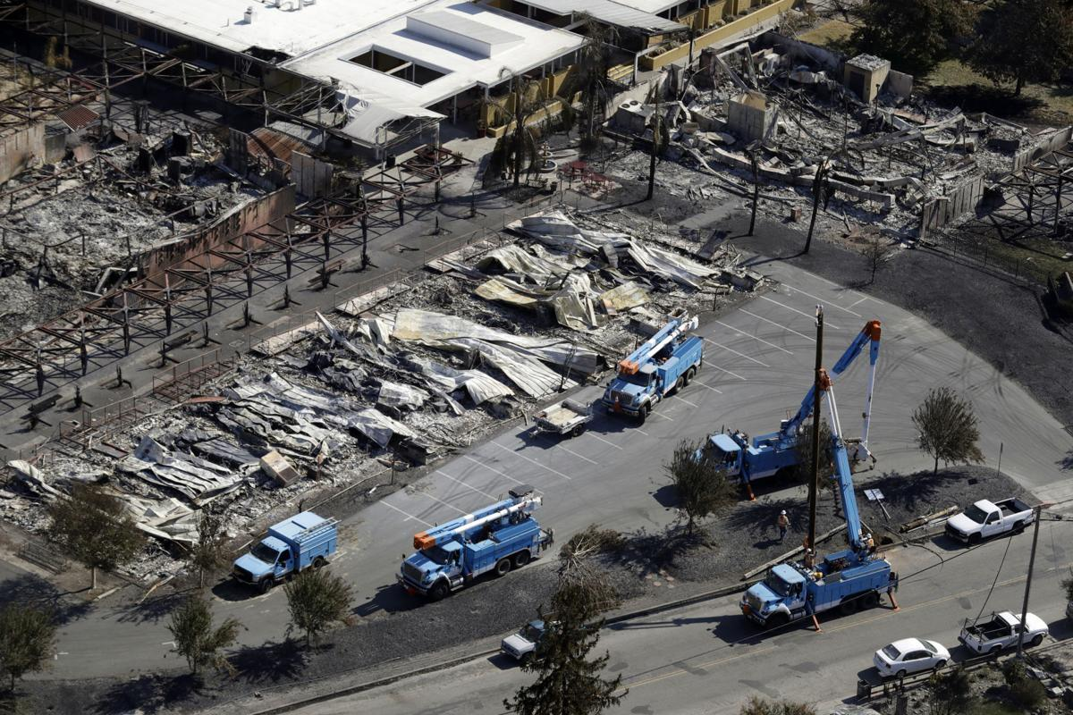 File In This Oct 14 2017 Photo Crews Of Pacific Gas Electric Corp Work On Restoring Lines A Fire Ravaged Neighborhood An Aerial