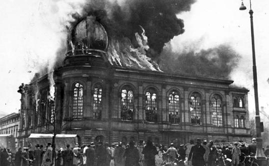 """A synagogue in Germany burns has people watch during the November, 1938 attacks on Germany's Jewish community which is known as """"Kristallnacht"""""""