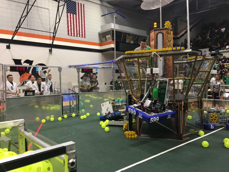 High school students are controlling their robots to climb a rope as part of the FIRST Robotics Regional Competition in Ventura