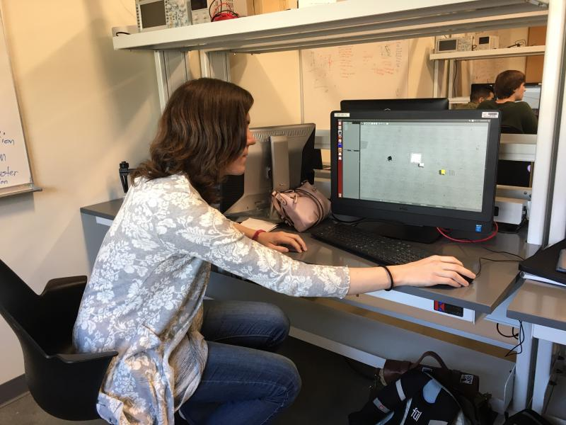 Kelsey Geiger, a CSUCI computer science student, is testing her algorithm using a simulator.