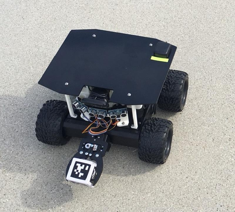 This small robot that CSUCI students built is collecting blocks.