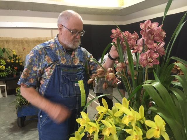 Orchid growers like Andy Cameron of Pasadena set up their plants at the Earl Warren Showgrounds in Santa Barbara