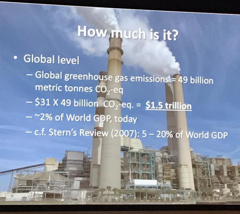 A slide on greenhouse gas emissions shown during the Climate Change Forum