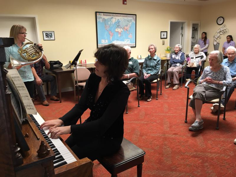 Pianist Erin Bonski and French horn player Stephanie Stetson perform in front of elderly dementia patients as part of a music therapy study in Santa Barbara.