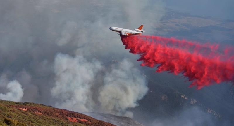 A converted DC-10 make a fire retardant drop near Santa Ynez Peak on the Whittier brush fire
