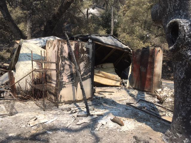One of the camp structures destroyed by the Whittier Fire