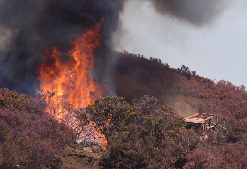 Firefighters battle the Whittier fire on West Camino Cielo Saturday