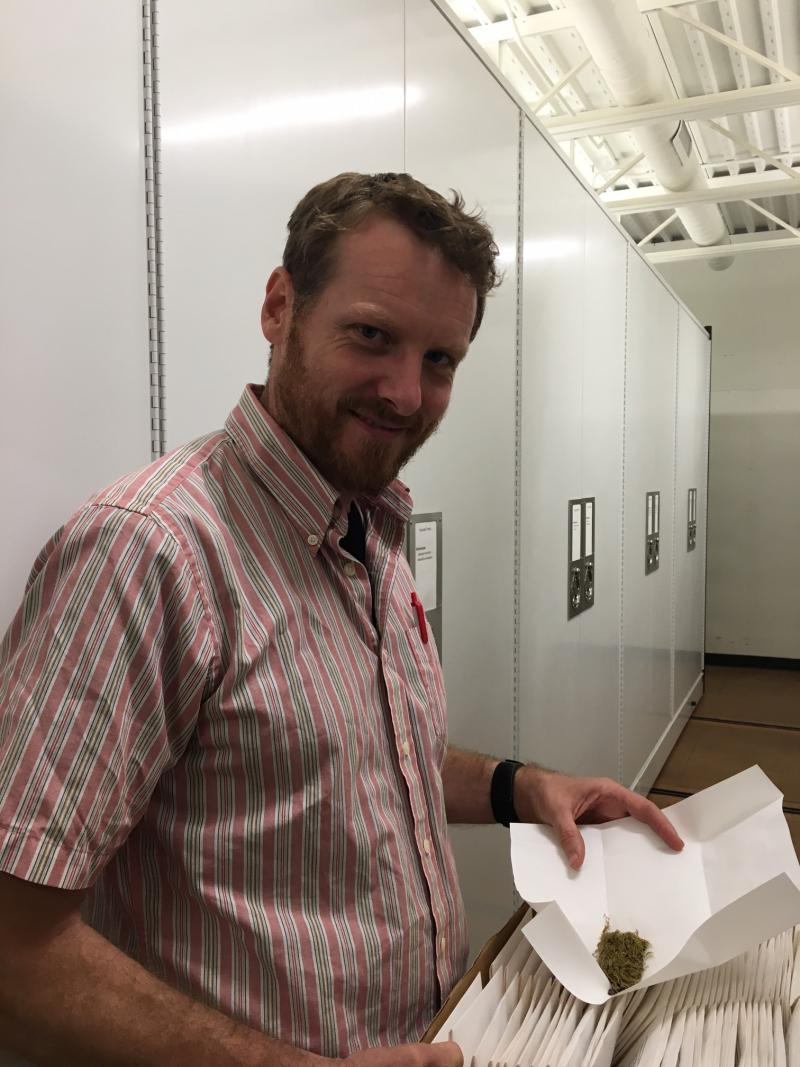 In the Herbarium, San Jose State University Botanist Ben Carter shows a moss that he found on the island
