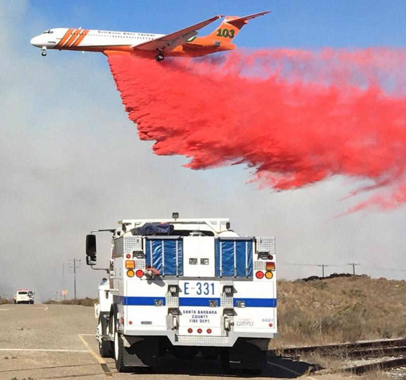 An air tanker making a drop on what's being called the Ensalada Fire, on Vandenberg Air Force Base.