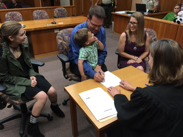 The Clayton family goes tghrough the final process of adopting three and a half year old Anthony in a ceremony at the Ventura County Juvenile Courthouse in El Rio