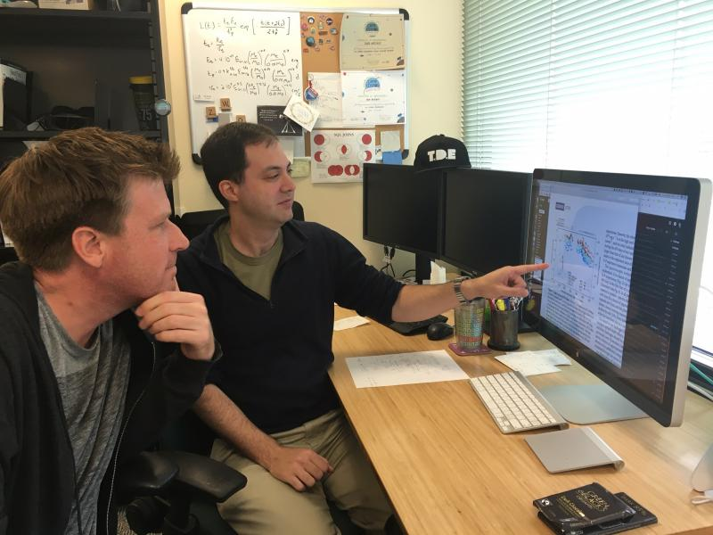 Astronomers Dr. Andy Howell and Dr. Iair Arcavi look at data from the supernova
