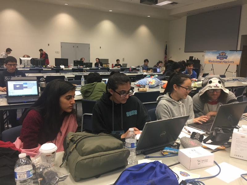 A team of high school students do computer coding during Hackathon by the Sea in Camarillo