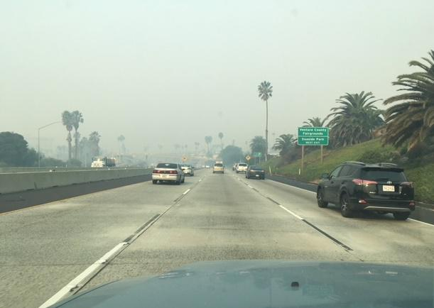 Dense smoke from the Thomas Fire blankets much of the South Coast, leading to unhealthful air quality.  This is the scene on Highway 101 in Ventura Friday morning