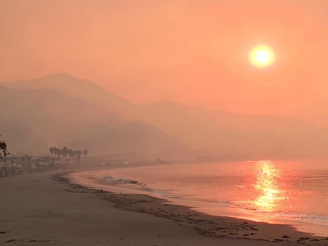 Smoke from the Thomas fire creates a surreal scene at the scene at Faria Beach, which was evacuated Tuesday night as the fire jumped Highway 101 and came within hundreds of yards of the ocean at spots