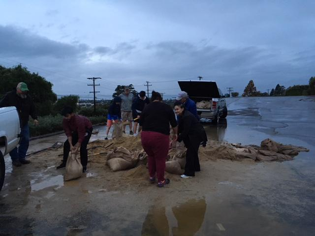 People fill sandbags Monday night at one of the stations set up by the City of Ventura