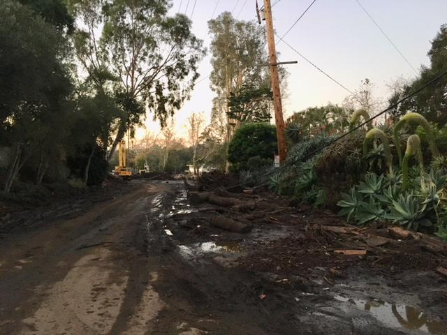 Crews at work Thursday morning to clear debris from the Hot Springs Road area of Montecito from Tuesday's storm