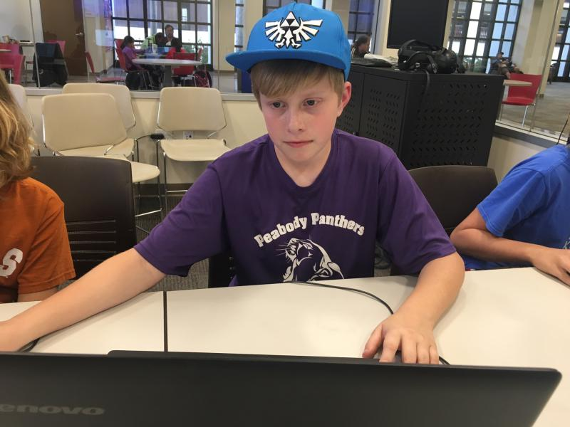 11-year-old Ty Kangas is learning how to create a video game at a computer science class at Santa Barbara Public Library
