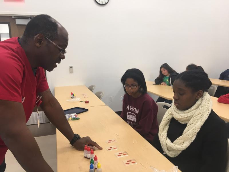 Wayne Thomas, a molecular biologist, is teaching students about blood typing