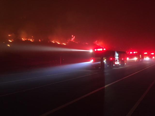 The Thomas Fire burns between Ventura and Santa Barbara County, closing a key coastal highway and threatening beachfront homes