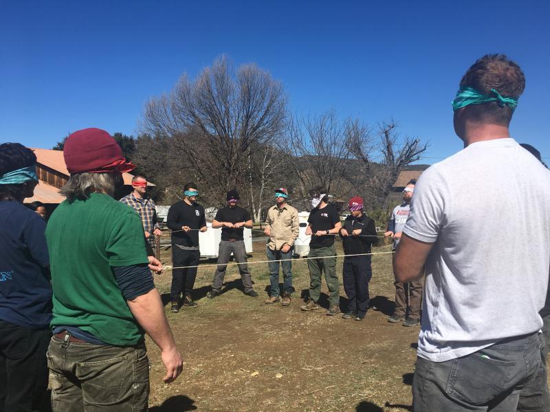 Many veterans doing team-building firefighting training exercise