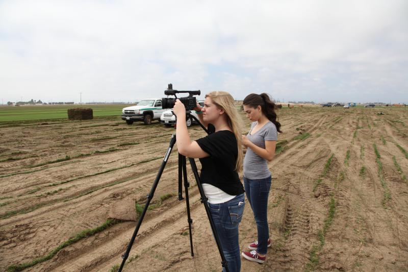 """Cal Lutheran students (who have since graduated) Kristiann Jones (left) and Karie Portillo Guerra filming """"Turf Wars"""""""