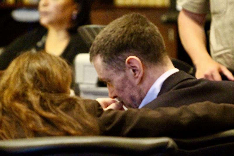Nicolas Holzer speaks with his attorney, Christine Voss, on Wednesday.