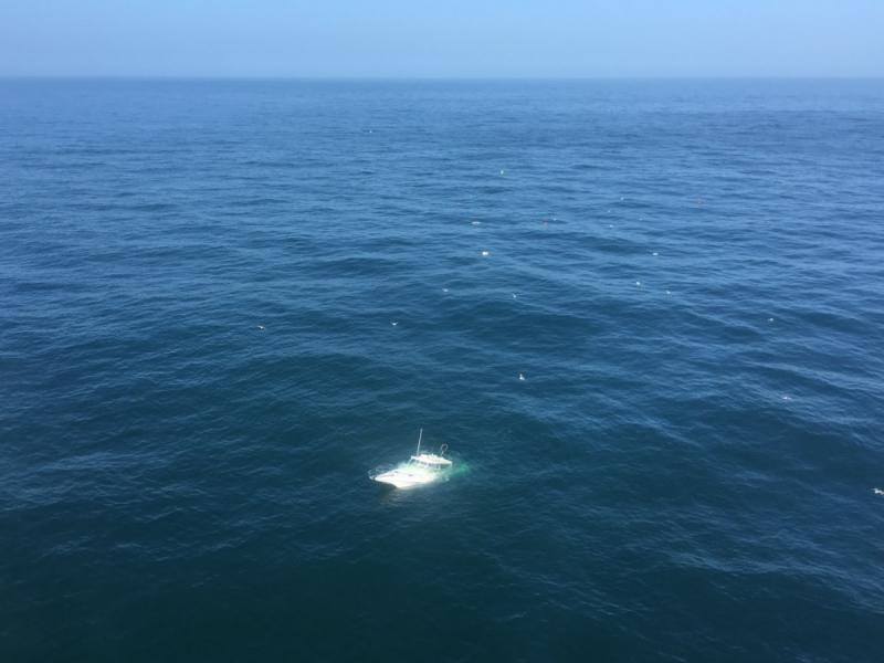 Photo from a Coast Guard helicopter of a craft sinking off of Ventura County Sunday morning.  All six people were rescued.