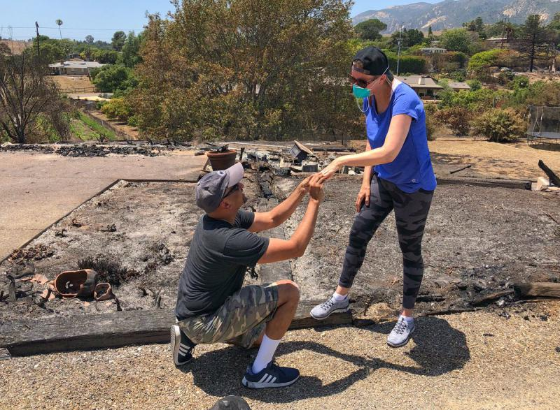 Ishu Rao renews his vows to his wife Laura after they find her wedding ring in the ruins of their North Fairview Avenue home