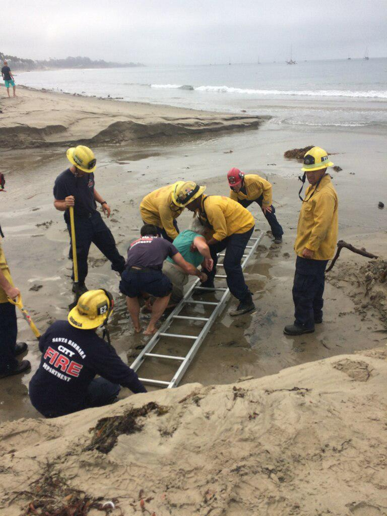 Santa Barbara firefighters rescue a woman stuck in quicksand like conditions at West Beach