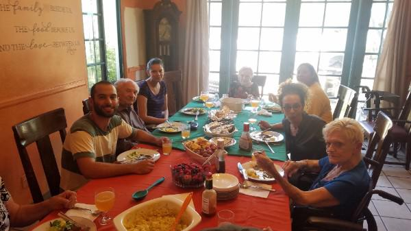 Residents of Sarah House, a hospice for low-income people, enjoy food donated by Pure Joy Catering through Santa Barbara County Food Rescue