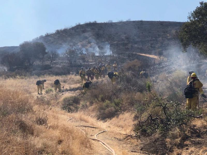 Firefighters work to contain brush fire in eastern Ventura County Wednesday