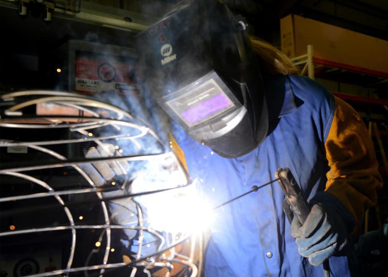 Student welding parts of float
