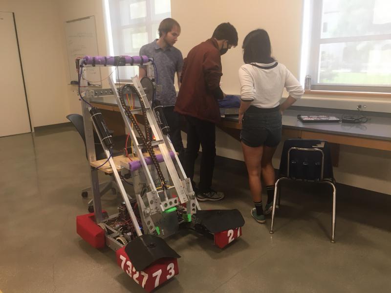 Students program a large robot to perform tasks
