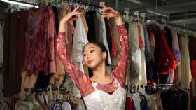 Dressed in an elaborately beaded gown, Sarah Chun poses in the costume shop.