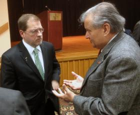 Anti-tax activist Grover Norquist (left), president of Americans for Tax Reform, talks to state Rep. Mario Goico, a Wichita Republican, after speaking to the Kansas Business Coalition for Immigration Reform in Topeka.