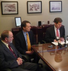 Kansas Governor Sam Brownback (r), Lt. Governor Jeff Colyer (middle) and Secretary of Corrections Ray Roberts (l) discuss strengthening the mental health safety net system at Wyandotte Center in Kansas City, Kan.