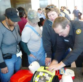 In the lobby of city hall, Kevin Fogarty (r), a paramedic with KCK's fire department, trains Tania Taylor (l), Clyde Welsh and Terri Rankin (r), from the city's water pollution department, in CPR.