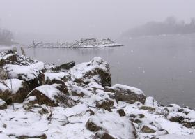 Unforgiving terrain along Missouri River's South bank. Kansas City Firefighters in boats searched in snow-reduced visibility for a man and woman seen jumping from a bridge.